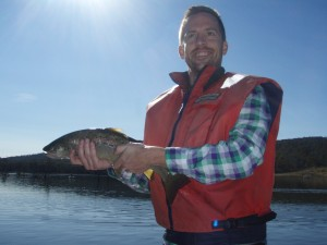 Leroy with a wild trout from Four Springs Lake Tasmania