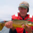 Phil holds a golden wild brown trout