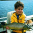 Young child holding a wild trout