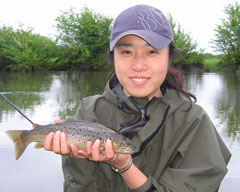 lady holding a wild Tasmanian Trout