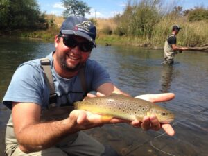 An anger holding a wild brown trout