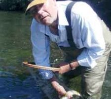Greg holding a brown trout