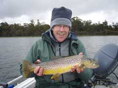 John holding a fine brown trout
