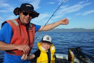 Matt and Campbell with Campbell's catch, a wrasse.